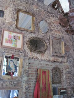 stone wall with mirrors and saints