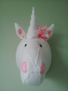 USAIN UNICORN Approximate dimensions - 15 high x 9 wide Colour - White, Light Pink  THE PERFECT ALTERNATIVE TO HAVING TO GO OUT AND SHOOT YOUR OWN ANIMAL TO HANG ON A WALL!!! WONDERFULLY WACKY HANDMADE FABRIC CREATIONS!  All my Wall Mounted Animal Heads are handmade by me, using various materials, and as with all handmade goods, slight variations can occur, no one product is exactly the same, but it is always to the highest of standards. Predominantly felt and fleece make up the bulk of the…