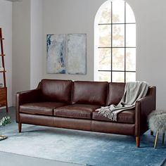 I like sofa/ladder shelf combo. Brown+blue combo  Hamilton Leather Sofa - Mocha (206 cm) | west elm UK