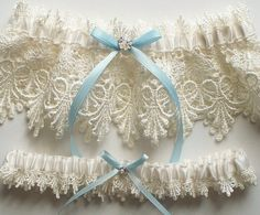 Wedding Garter Set with Blue Satin Ribbon Bow and Swarovski Crystal Centering - The ALICIA Garter Set. $32.50, via Etsy.