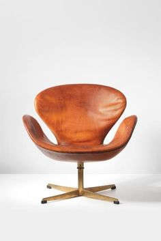 "Arne Jacobsen | ""Swan"" swivel chair, designed for the Royal Hotel for SAS, Copenhagen 1958 Leather, bronze. 28 3/4 x 28 3/4 x 26 5/8 in. (73 x 73 x 67.5 cm) Manufactured by Fritz Hansen, Denmark. Underside of chair with manufacturer's printed logo FH and MADE IN DENMARK and underside of bronze stand cast with 2."