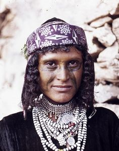 Northern Yemen   Portrait of a woman, the 'paint' on her face is made from herbs. ca. 1972 - 1985