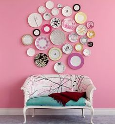 love the idea of collecting vintage plates and displaying them like this. i also love the pop of color