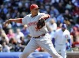 Alfredo Simon lowers ERA, leads Reds over reeling Cubs