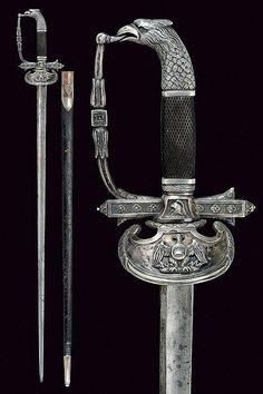 A rare silver mounted small-sword with eagle on the pommel. The tip of the hand guard is in the bird's mouth. Italy, 1800.