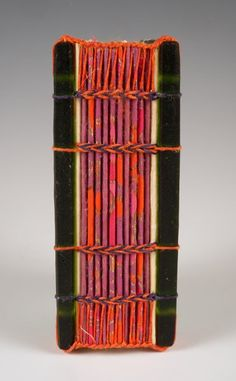 """Handmade book by Donna Branch. Glass, cast, carved, sandblasted, acid-etched; handmade papers, Irish waxed linen, binding is 4th Century Ethiopian Coptic with Coptic endbands, closure is wooden button, 4 3/8""""X2 5/8""""X1 3/4"""""""