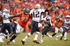 Malik Jackson #97 of the Denver Broncos pressures Tom Brady #12 of the New England Patriots in the third quarter in the AFC Championship game at Sports Authority Field at Mile High on January 24, 2016 in Denver, Colorado. (Jan. 23, 2016 - Source: Doug Pensinger/Getty Images North America)