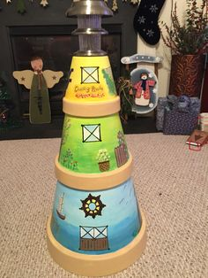 Hand painted clay pot lighthouse