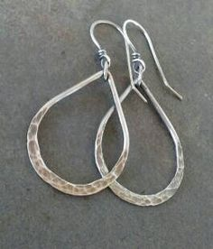 This pair of earrings os handmade by me using sterling silver wire. This pair measures 2 1/8 inches in length from the top of the ear wire to the bottom of the hoop. They have been oxidized to show detail and give them rustic charm.