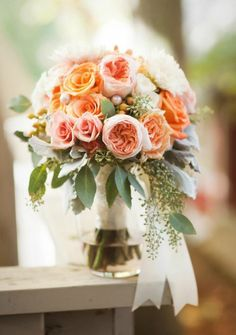 Wow. The roses are a little too orange , but the shape and arrangement of this is spot on!