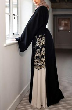Buy our stunning black closed abaya with pretty gold pearl/lace detailing throughout. The abaya has an internal belt allowing instant tailoring to your own size, an impressive and striking abaya ideal for special occasions! Iranian Women Fashion, Islamic Fashion, Muslim Fashion, Abaya Designs Latest, Modest Casual Outfits, Modern Abaya, Niqab Fashion, Islamic Clothing, Custom Dresses