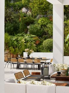 An extension of the main living room area with a dining table by Living Divani and chairs by Meridiani. The cushions are... Indoor Outdoor Living, Outdoor Lounge, Outdoor Spaces, Outdoor Decor, Outdoor Dining, Dining Area, Dining Table, Architectural Features, Architectural Digest