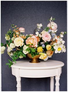 I'm fond of the color scheme of this arrangement. It reminds me of a Dutch still life painting.
