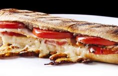Super Club Panini with Grain Mustard: Part turkey club and part warm, gooey panini, this sandwich hits the spot every time with its combination of wafer-thin turkey, sharp Cheddar, spicy mustard, and smoky bacon.