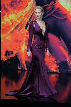 Jennifer Lawrence in Dior at the Berlin premiere of Mockingjay-Part 2. The sleeves need to go, otherwise this dress is gorgeous!