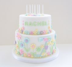 7th birthday cake for my daughter. Simple design with cut out flowers in pastel colours.