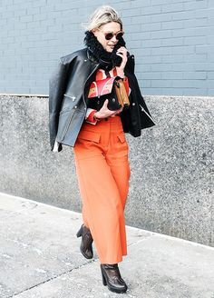 Enliven your leather jacket with bright separates, like a printed top and colorful trousers.