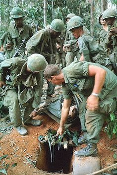 Dak To, South Vietnam. Plasma is given to a wounded member of the 173rd Airborne Brigade on Hill 875 as he is carried through the densely wooded area.  Flickr - Photo Sharing!   Vietnam War