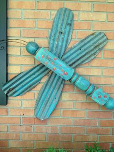 Dragonfly made with table leg and old corrugated tin, painted in turquoise.