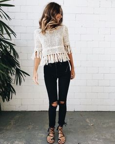 Cute off white fringed top with distressed black denim jeans. #wearablesclothing