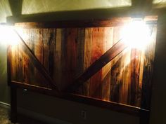 Here is a Beautiful handmade barn style king size headboard with mason jar lights, made from 100% pallet wood, by Angry Wood Design. Visit their Facebook page at https://www.facebook.com/angrywooddesign/ to see more of their cool  pieces!