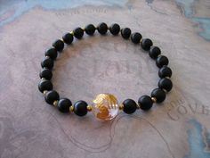 Buy Carved chinese ( golden dragon ) quartz & frosted black onyx bracelet by shynnasplace. Explore more products on http://shynnasplace.etsy.com