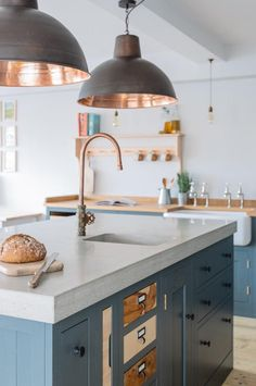 kitchen island with copper sink and copper faucet with other copper accents