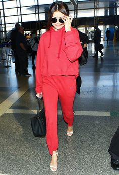 WHAT: Los Angeles International Airport, March 2016 WEAR: Vetements Hooded Logo Print Sweatshirt (£415) and Cut-Out Cuff Track Pants (£375).