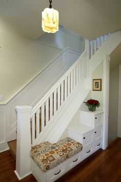 bench and storage at staircase & love the hand rail