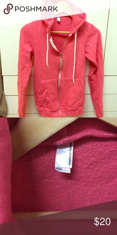 American apparel coral pink zip fleece hoodie XXS American apparel runs about a bit big so this would fit a xsmall as well. I am a XS-S and fbis fits me. Retails for $50. Style F497 American Apparel Tops Sweatshirts & Hoodies