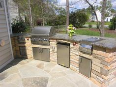 backyard patio with kitchen ideas | This custom outdoor kitchen design has space for several outdoor chefs ...