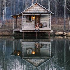 I love this cabin with a side porch over the water | Andrew's Social Media