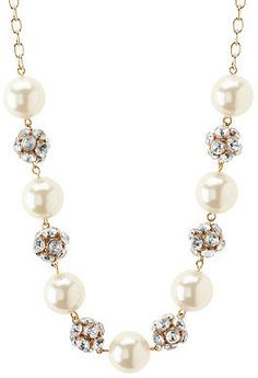 Rhinestone & Pearl Statement Necklace - Jumbo faux pearls link to sparkling rhinestone spheres, creating major sparkle on a collar-length golden chain $6 at Charlotte Russe.