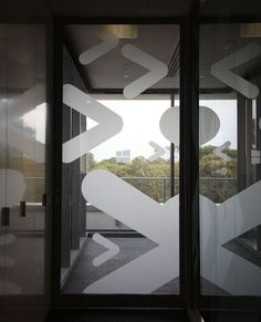 Adding frosting to only parts of glass surface can be a useful way to add branding to these types of spaces.