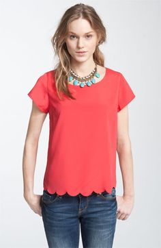 I think I could make a knock-off version this scalloped hem top, since it's so simple.