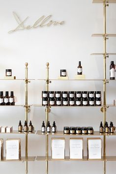 Boutique by christophe remy brussels cosmetic display, cosmetic shop, cosme Brass Shelving, Retail Shelving, Gold Shelves, Pipe Shelving, Store Shelving, Bar Shelves, Adjustable Shelving, Shelving Display, Storage Shelves