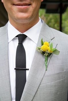 Groom's Bout - will have finished stem wrap with grey ribbon and use the little daisy in place of baby's breath to match bouquets