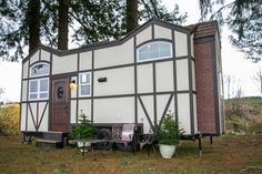 This is a beautiful Tudor-style tiny house on wheels by Tiny Heirloom. It was featured on a recent episode of their television series, Tiny Luxury which is on the HGTV/DIY Network. Tiny House Swoon, Tiny House Living, Tiny House Plans, Tiny House On Wheels, Tiny House Design, Tiny House Nation, Tiny House Trailer, Shipping Container Home Builders, Shipping Containers