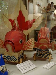 japan toy museum: vintage regional folk toys including kokeshi dolls, daruma figures, paper fish and a plaster dog.2009/Japan toy museum: vintage regional folk toys including kokeshi dolls, daruma figures, paper fish and a plaster dog.