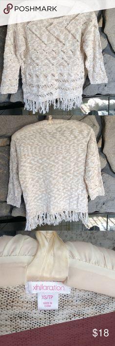 Light tan & white marled fringed sweater Pretty cutout pattern sweater with fringed hem, 3/4 sleeves, crew neck.  Hardly worn. Smoke free home. Xhilaration Sweaters Crew & Scoop Necks