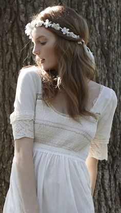 white dresses and flower crowns. I like this for pre-wedding pics... maybe even some engagement