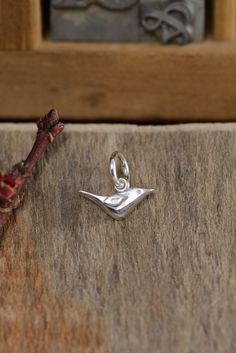 Tiny sterling silver sparrow symbolizes how we are cared for by the King. A beautiful reminder to lay our worries before our God, who cares for us. Charm measures: 7/8″ x 1/4″...