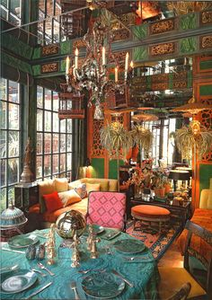 I love this peacock colored table and eclectic mix of Malachite printed fabrics - very Bohemian!