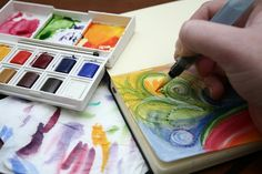 "art journal idea - water color ""scribbles"" with scribbles and sketches over the top"