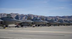 Five F-22 Raptors from Tyndall Air Force Base, Fla. sit on the flightline during the first day of Red Flag 16-1, Jan. 25 at Nellis AFB, Nev. Red Flag is a joint, full-spectrum, readiness exercise designed to provide the most realistic combat training available. (U.S. Air Force photo by Senior Airman Alex Fox Echols III/Released)