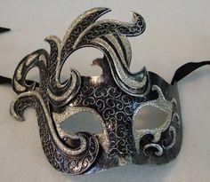 Venetian Thunder Black & Silver Mask Mardi Masquerade Halloween Costume by Mardi Gras World, http://www.amazon.com/dp/B0078H42TS/ref=cm_sw_r_pi_dp_EBGxqb01NP0YH