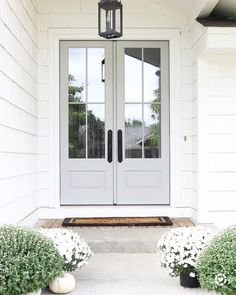A Feminine Farmhouse Home Tour Faded blue double front door with black handles and window panels – Entryway ideas - Door Front Door Entryway, Front Door Porch, Front Doors With Windows, Double Front Doors, Glass Front Door, Front Door Decor, Entry Doors, Entryway Ideas, Door Ideas
