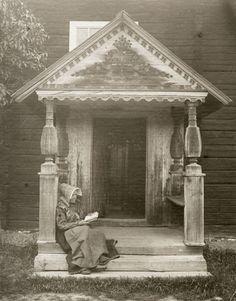 Woman on a porch, Dalarna, Sweden. Undated.