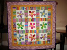 Scrappy daisy quilt made for a niece - great scrap buster!