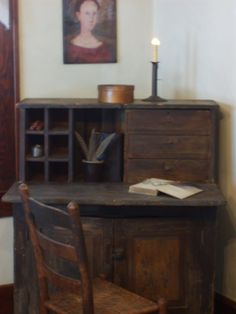 EARLY DESK WITH DRAWERS &  CUBBIES AND A FOLKART PORTRAIT ABOVE. * The Keeping Room.